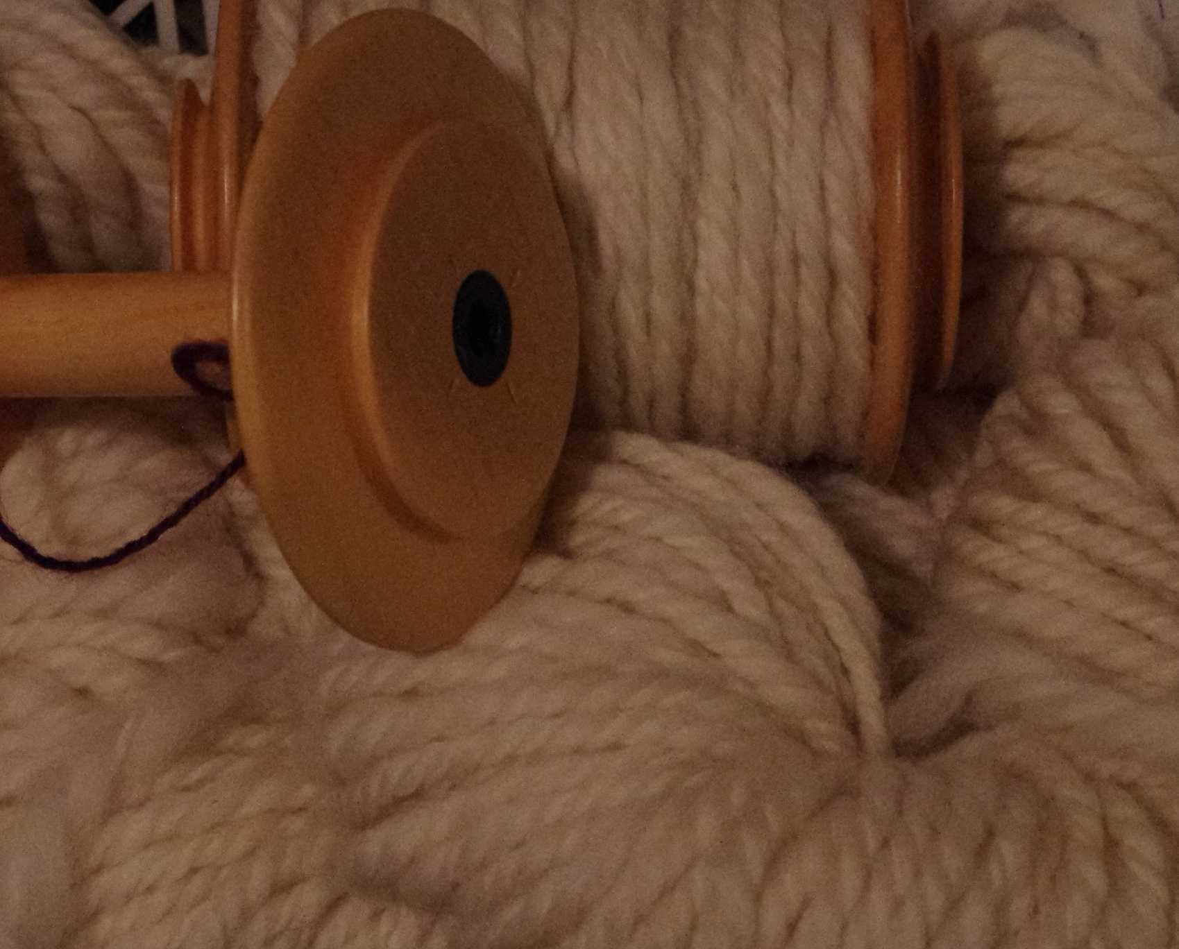 Jumbo bobbins and plyed Merino wool